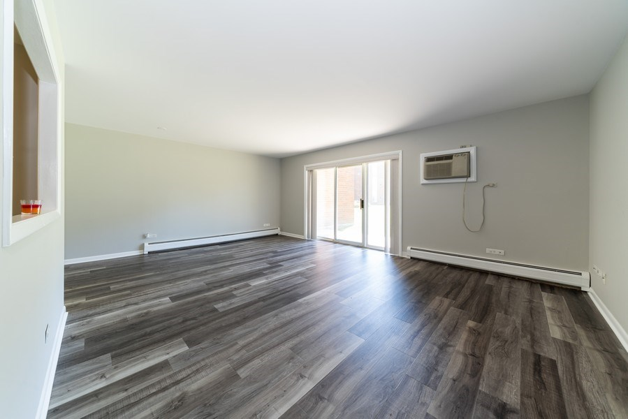 Real Estate Photography - 4225 Saratoga Ave, 105B, Downers Grove, IL, 60515 - Living Room / Dining Room