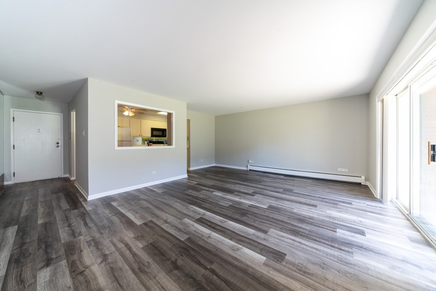 Real Estate Photography - 4225 Saratoga Ave, 105B, Downers Grove, IL, 60515 - Living Room/Dining Room