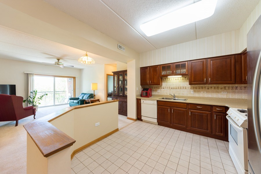 Real Estate Photography - 3401 N. Carriageway Drive, Unit 303, Arlington Heights, IL, 60004 - Kitchen / Breakfast Room