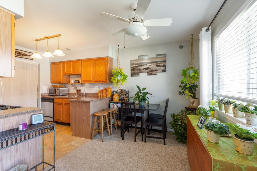 Real Estate Photography - 719 E. Whispering Oaks Drive, Unit 2RY, Palatine, IL, 60074 - Dining Room