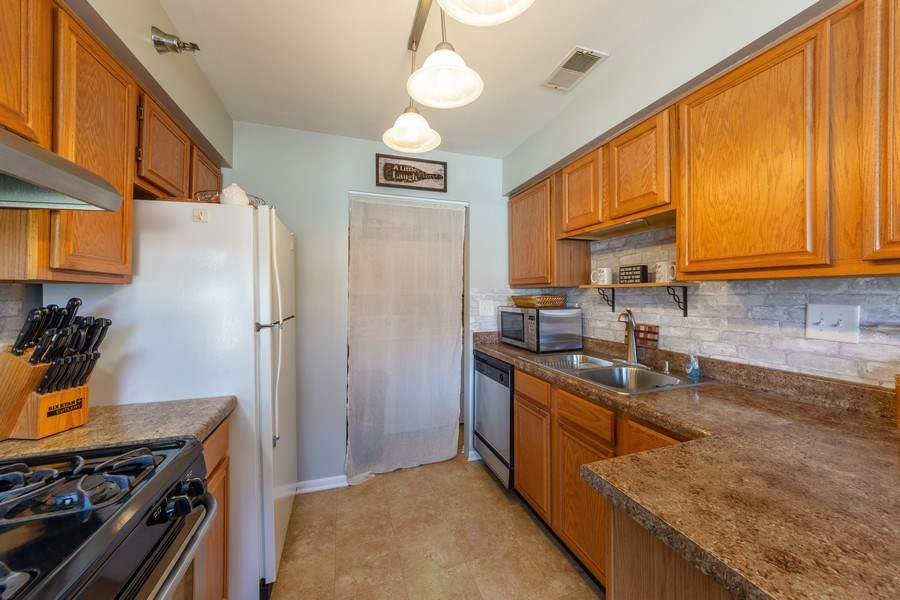 Real Estate Photography - 719 E. Whispering Oaks Drive, Unit 2RY, Palatine, IL, 60074 - Kitchen