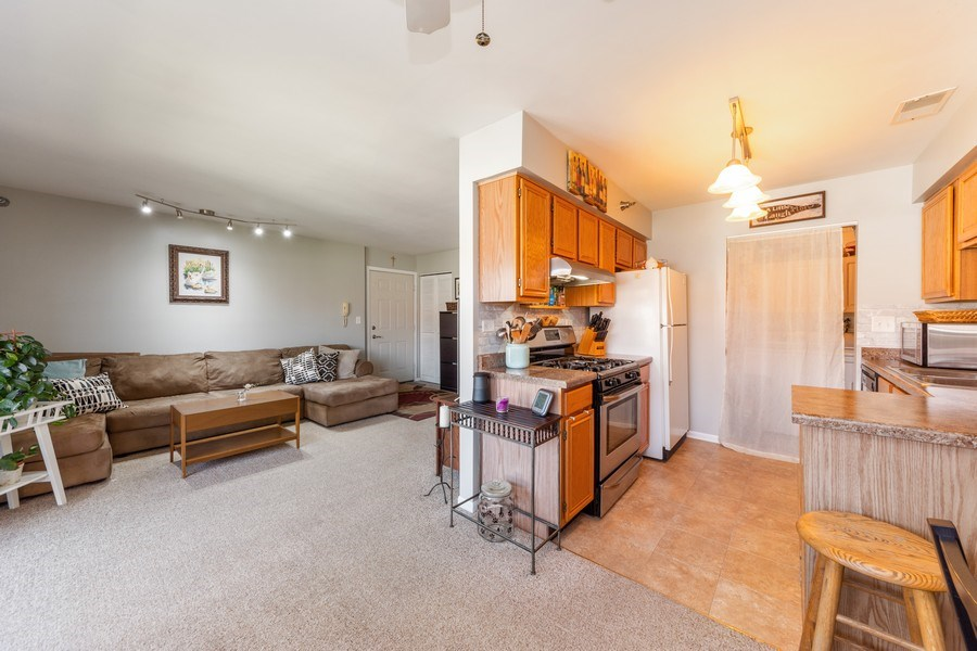 Real Estate Photography - 719 E. Whispering Oaks Drive, Unit 2RY, Palatine, IL, 60074 - Kitchen / Living Room