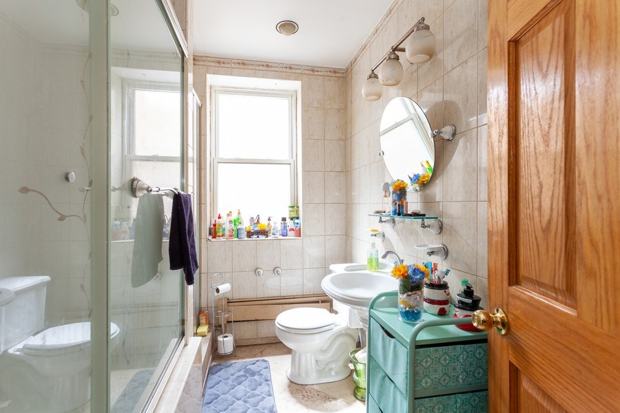 Real Estate Photography - 5040 West Cullom Ave, Chicago, IL, 60641 - Unit 1 - Bathroom