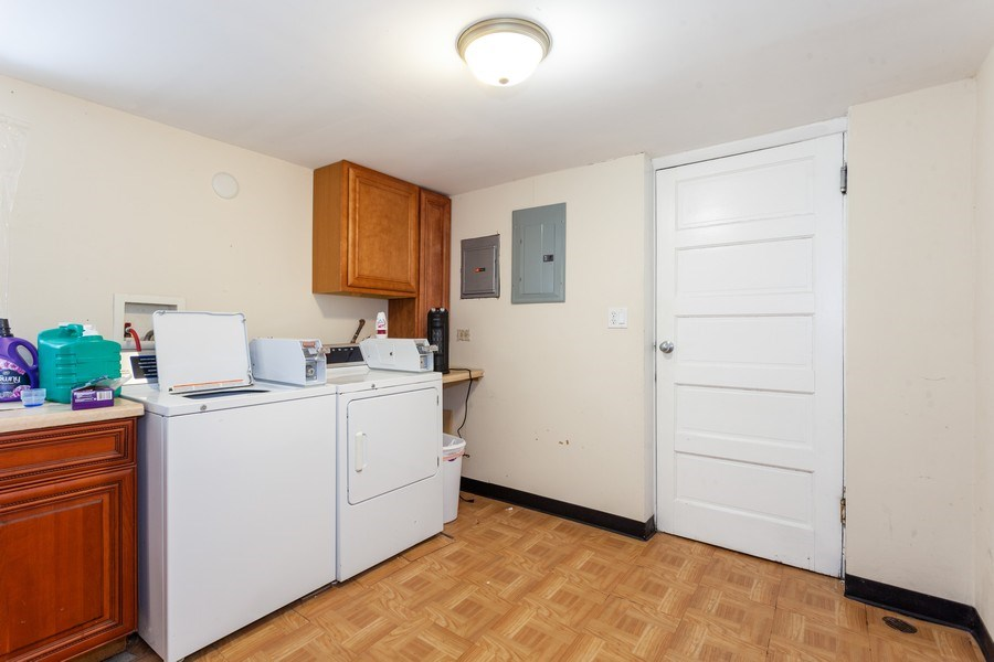 Real Estate Photography - 5040 West Cullom Ave, Chicago, IL, 60641 - Lower Level Laundry Room