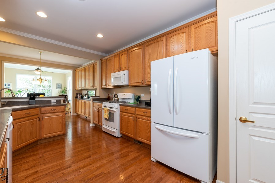 Real Estate Photography - 2544 Harvest Vly, Elgin, IL, 60124 - KITCHEN OPENS TO SUNROOM