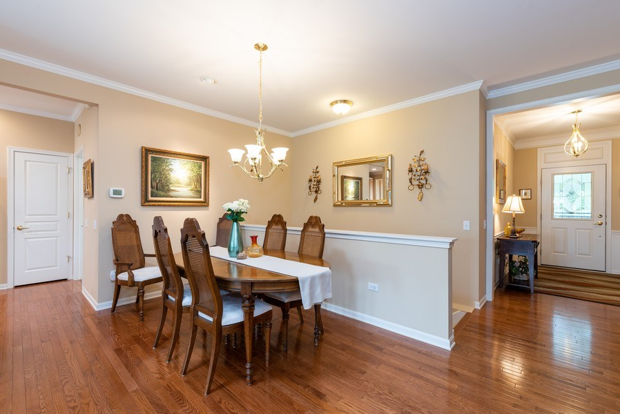 Real Estate Photography - 2544 Harvest Vly, Elgin, IL, 60124 - DINING ROOM WITH STAIRCASE TO FINISHED BASEMENT