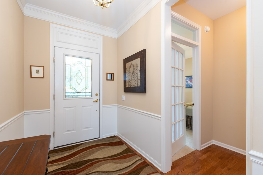 Real Estate Photography - 2544 Harvest Vly, Elgin, IL, 60124 - FOYER AND DOOR TO FRONT DEN/BEDROOM