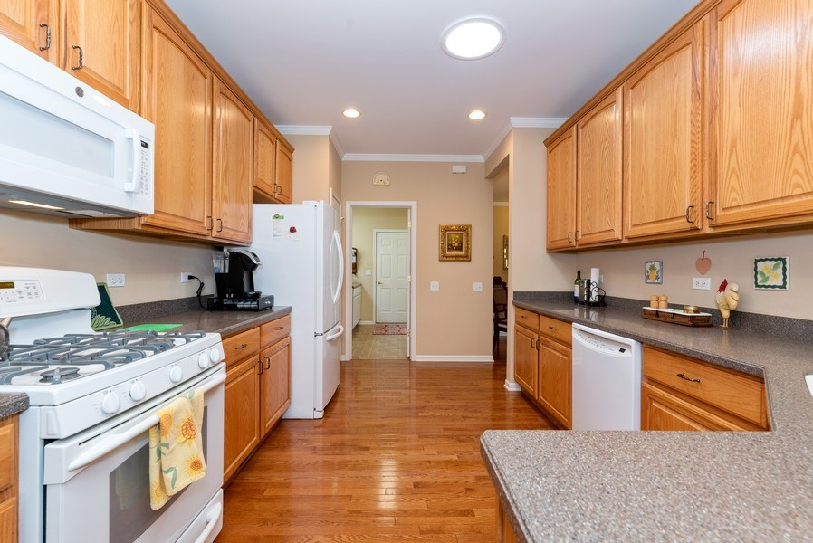 Real Estate Photography - 2544 Harvest Vly, Elgin, IL, 60124 - CABINETS ++ AND CORIAN COUNTERS**AND SOLAR LIGHT
