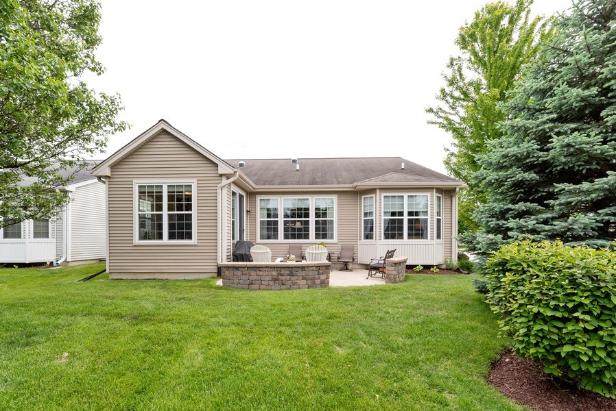 Real Estate Photography - 2544 Harvest Vly, Elgin, IL, 60124 - REAR ELEVATION WITH SUNROOM AND BAY WINDOW & PATIO