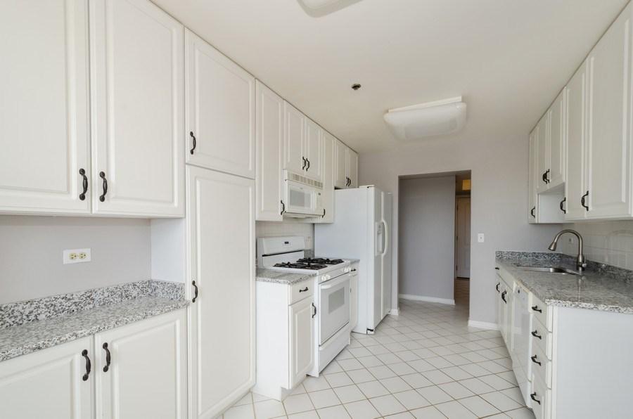 Real Estate Photography - 6411 Lincoln Avenue, Unit 503, Morton Grove, IL, 60053 - Kitchen