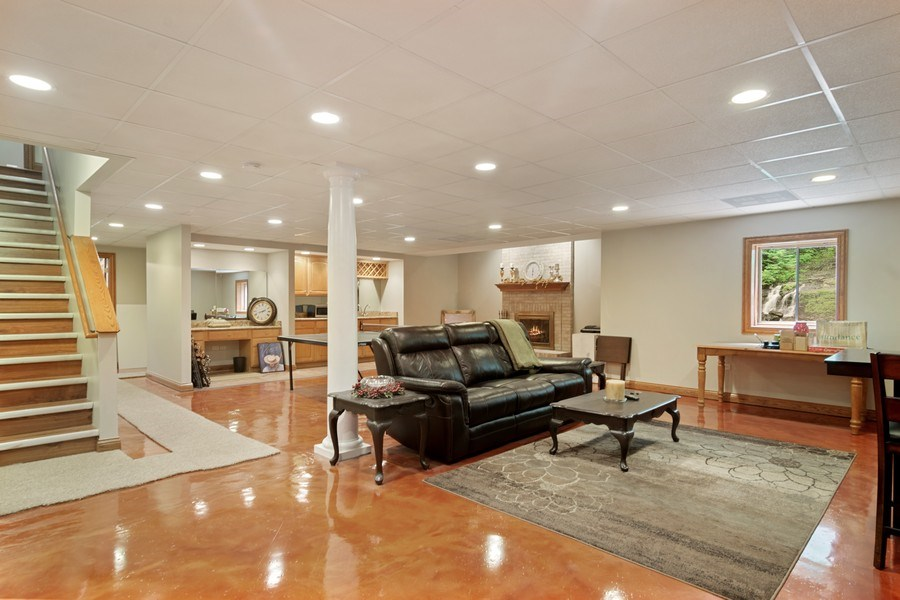 Real Estate Photography - 117 LUCY Court, Lake Zurich, IL, 60047 - Basement with Fireplace and Wet Bar