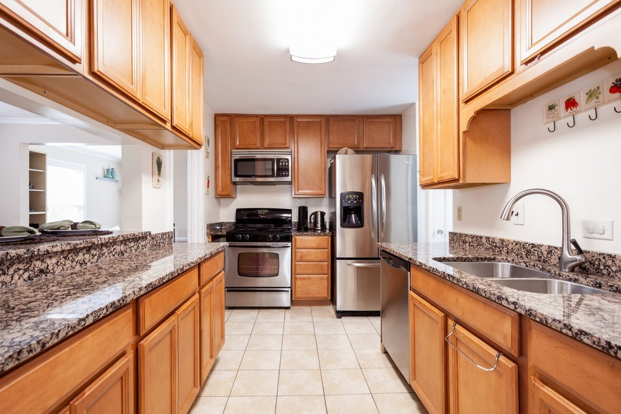 Real Estate Photography - 1621 Belleview Avenue, Westchester, IL, 60154 - Kitchen Features Window to Dining Room