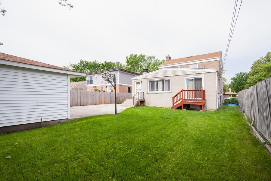 Real Estate Photography - 1621 Belleview Avenue, Westchester, IL, 60154 - Beautiful Backyard is Fully Fenced