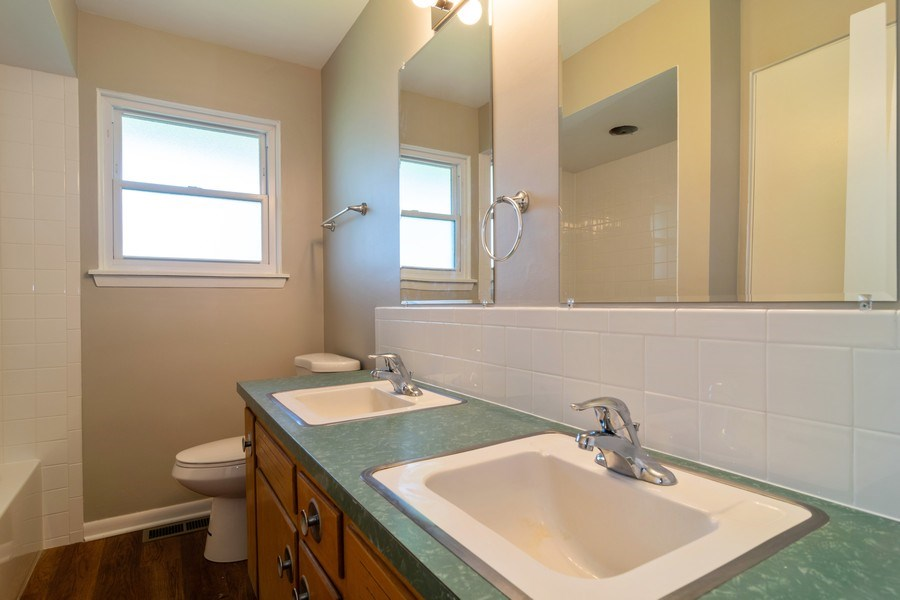 Real Estate Photography - 21W516 Army Trail Rd, Addison, IL, 60101 - Bathroom
