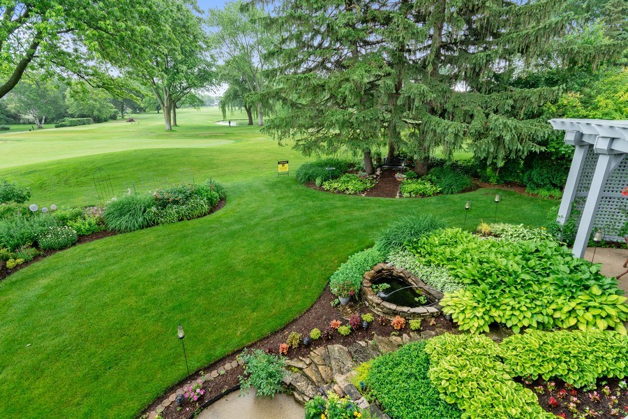 Real Estate Photography - 821 Burning Tree Ln, Naperville, IL, 60563 - The 18th fairway and lush gardens