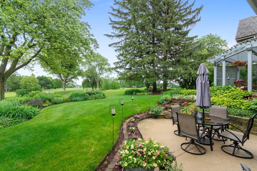 Real Estate Photography - 821 Burning Tree Ln, Naperville, IL, 60563 - A view of the two backyard pations
