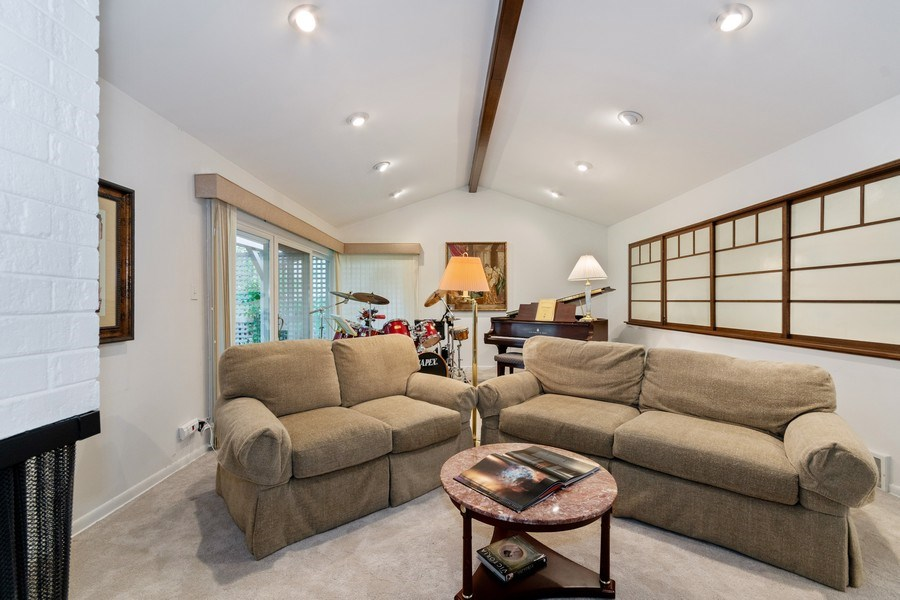 Real Estate Photography - 821 Burning Tree Ln, Naperville, IL, 60563 - Cathedral ceiling in the spacious LR