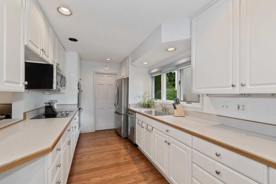 Real Estate Photography - 821 Burning Tree Ln, Naperville, IL, 60563 - Wonderful work & storage in this great kitchen!