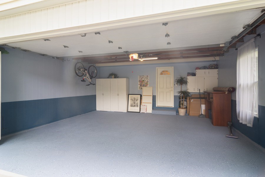 Real Estate Photography - 1339 E. Best Drive, Arlington Heights, IL, 60004 - Garage remodeled with epoxy floor