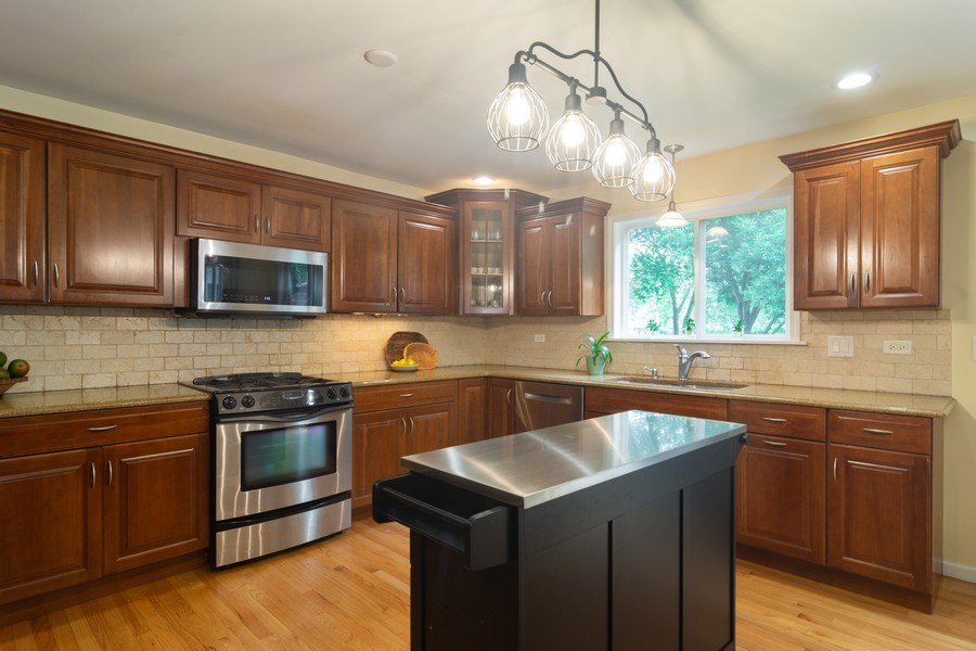 Real Estate Photography - 1339 E. Best Drive, Arlington Heights, IL, 60004 - Kitchen with abundant cabinetry & countertops