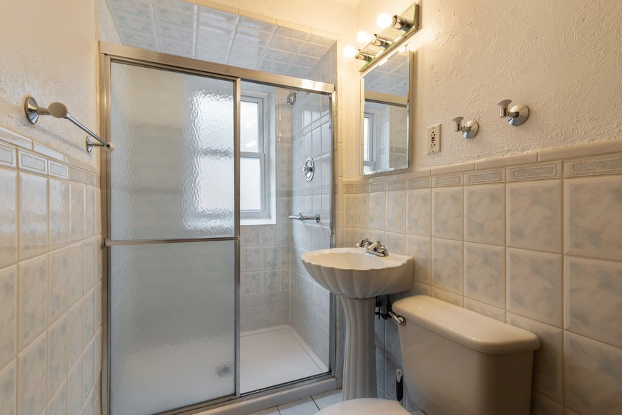 Real Estate Photography - 6751 N. Ozanam Avenue, Chicago, IL, 60631 - Bathroom