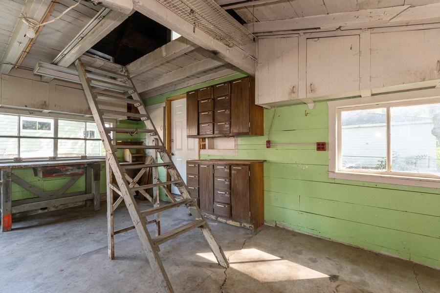 Real Estate Photography - 740 Walnut Street, Batavia, IL, 60510 - Garage workshop w Attic storage