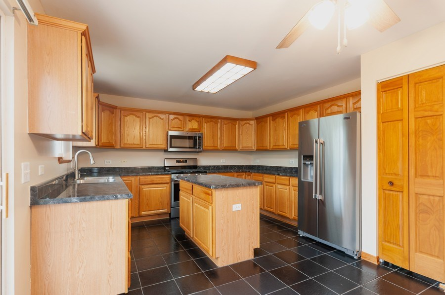Real Estate Photography - 2708 W. Lucia Avenue, Waukegan, IL, 60085 - Kitchen