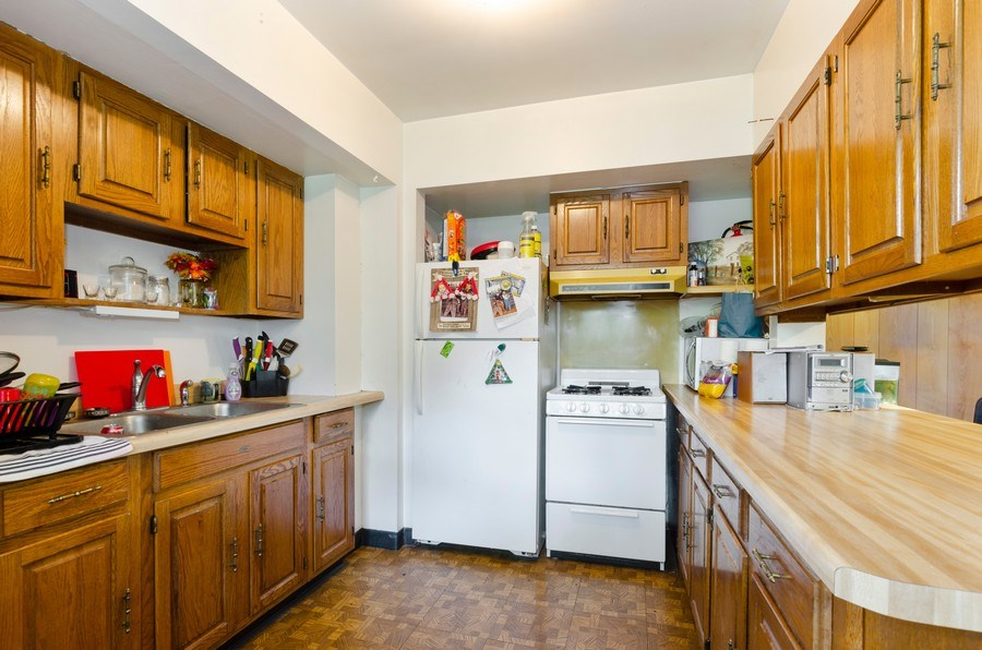 Real Estate Photography - 35W252 Country School Road, Dundee, IL, 60118 - 2nd Floor Unit - Kitchen