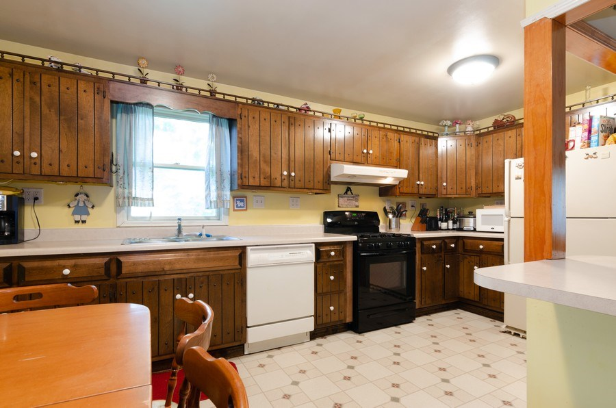 Real Estate Photography - 35W252 Country School Road, Dundee, IL, 60118 - Kitchen - Main Level Unit
