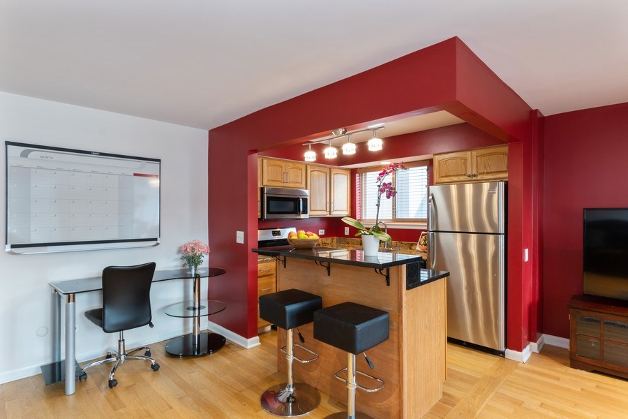 Real Estate Photography - 4881 N. Hermitage Avenue, Unit 102, Chicago, IL, 60640 - KITCHEN OPENS TO LIVING AREA