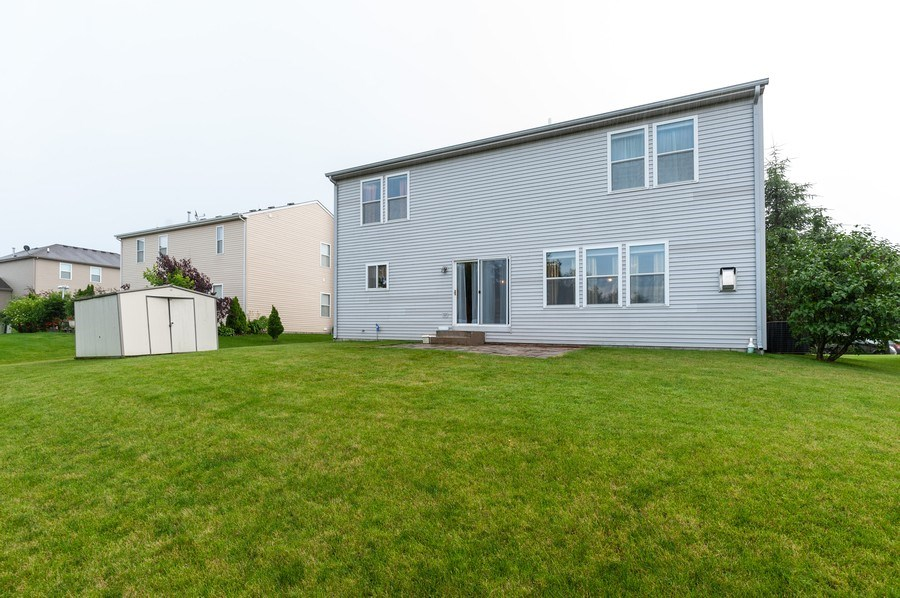 Real Estate Photography - 3912 Stonebridge Drive, Zion, IL, 60099 - Rear View