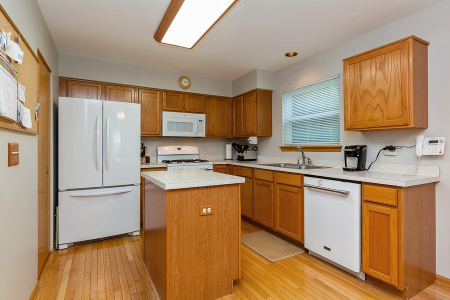 Real Estate Photography - 2445 Meadowsedge Lane, Carpentersville, IL, 60110 - KITCHEN--Tons of cabinet space!!
