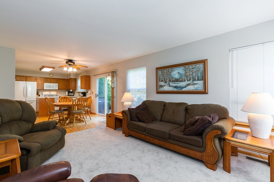 Real Estate Photography - 2445 Meadowsedge Lane, Carpentersville, IL, 60110 - FAMILY ROOM--Wide open views of the kitchen!