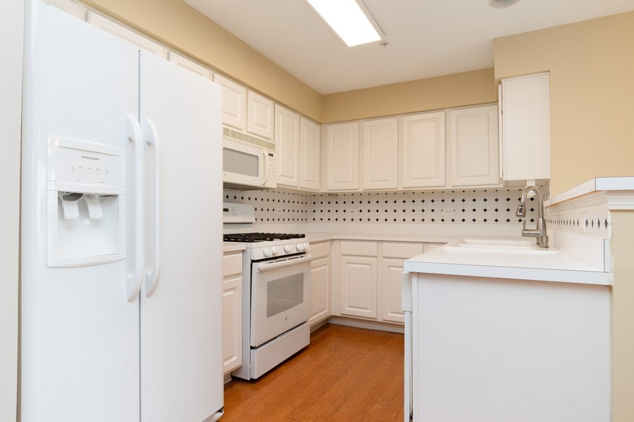 Real Estate Photography - 2454 Frost Drive, Unit 2454, Aurora, IL, 60503 - Kitchen