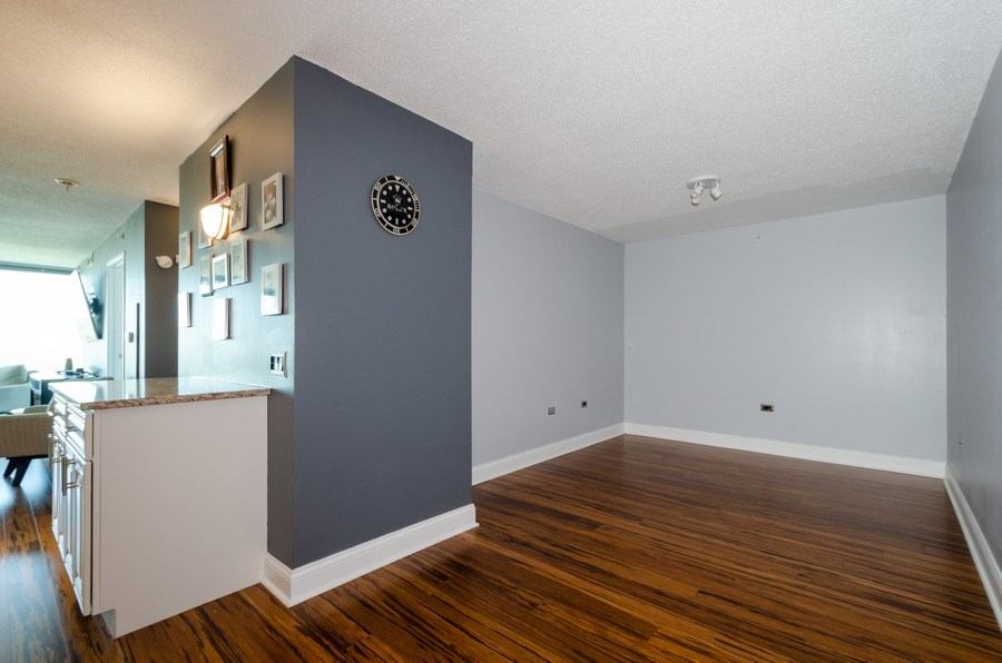Real Estate Photography - 800 Elgin Road, Unit 1508, Evanston, IL, 60201 - Dining Room