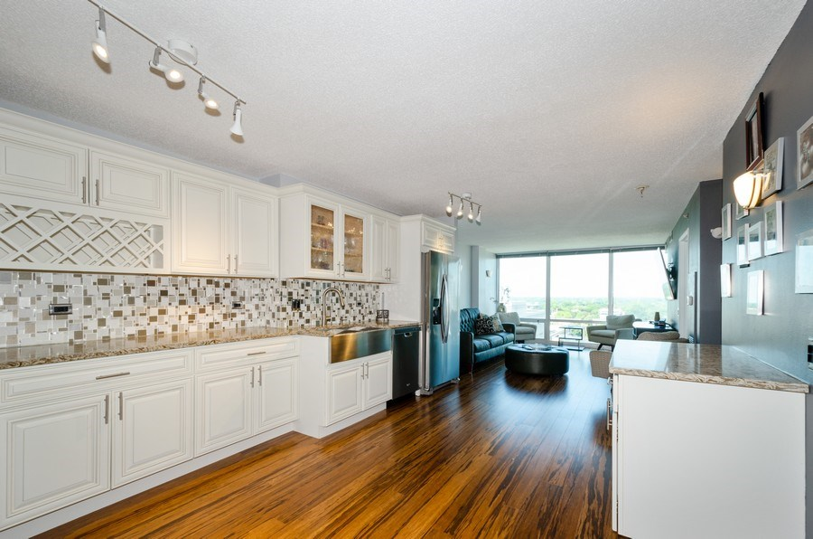 Real Estate Photography - 800 Elgin Road, Unit 1508, Evanston, IL, 60201 - Kitchen / Living Room