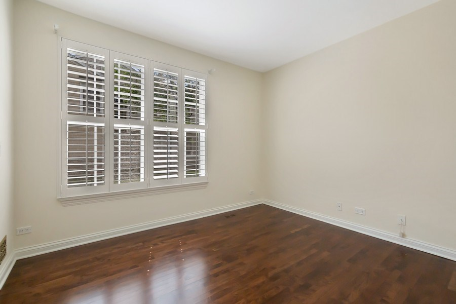 Real Estate Photography - 2315 Chestnut Avenue, Glenview, IL, 60026 - 1st Floor Bedroom with Full Closet and Adjacent Fu