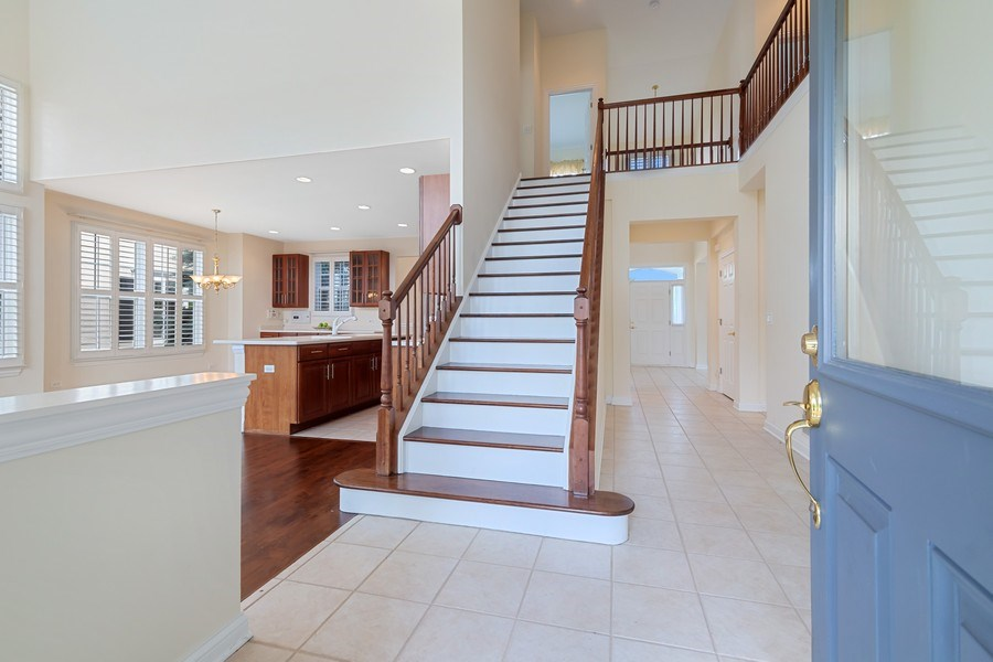Real Estate Photography - 2315 Chestnut Avenue, Glenview, IL, 60026 - Rear Foyer with gorgeous Bridal Staircase