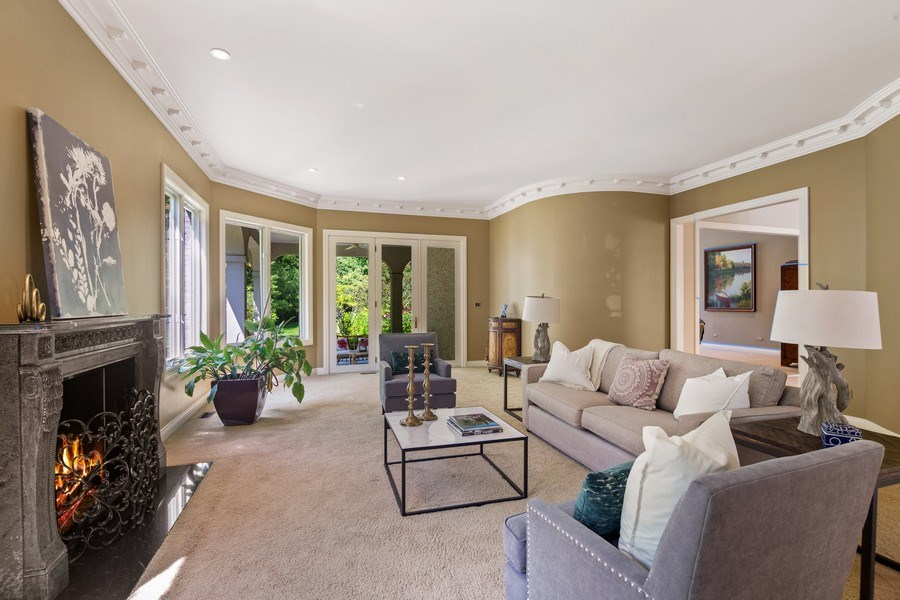 Real Estate Photography - 1660 ROBINWOOD Lane, Riverwoods, IL, 60015 - Living room with view of yard and walk out to cove