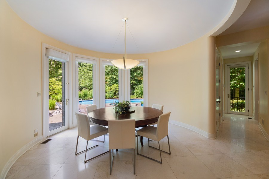 Real Estate Photography - 1660 ROBINWOOD Lane, Riverwoods, IL, 60015 - Eating area in kitchen with views of pool and yard