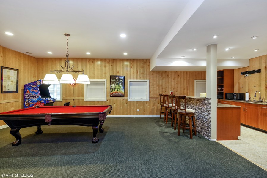Real Estate Photography - 1660 ROBINWOOD Lane, Riverwoods, IL, 60015 - finished basement with game area and kitchen