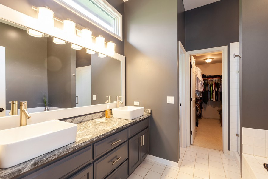 Real Estate Photography - 7 Fenview Ct, Bolingbrook, IL, 60440 - 1st floor master bath with walk-in closet