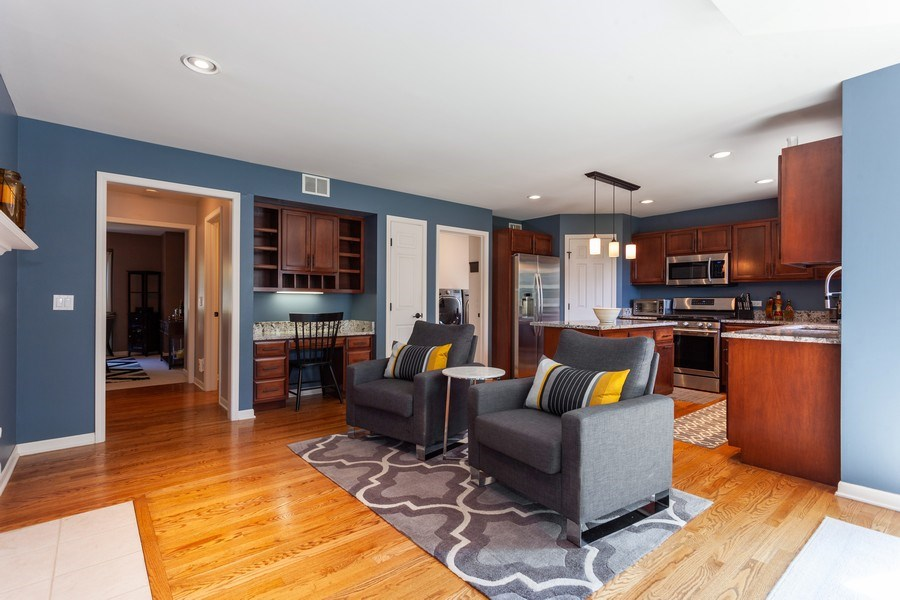 Real Estate Photography - 7 Fenview Ct, Bolingbrook, IL, 60440 - Sitting area and kitchen