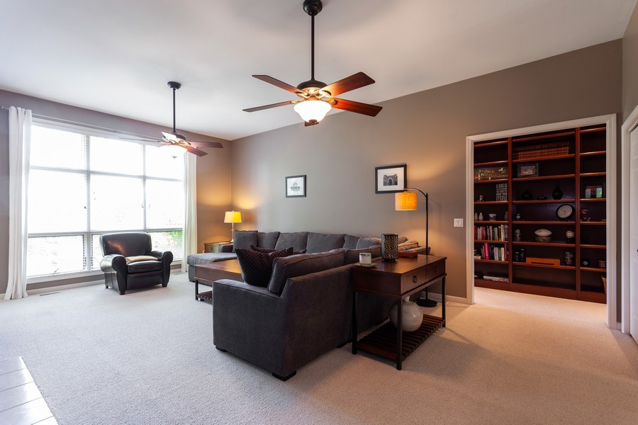 Real Estate Photography - 7 Fenview Ct, Bolingbrook, IL, 60440 - Family room and built-in bookshelf