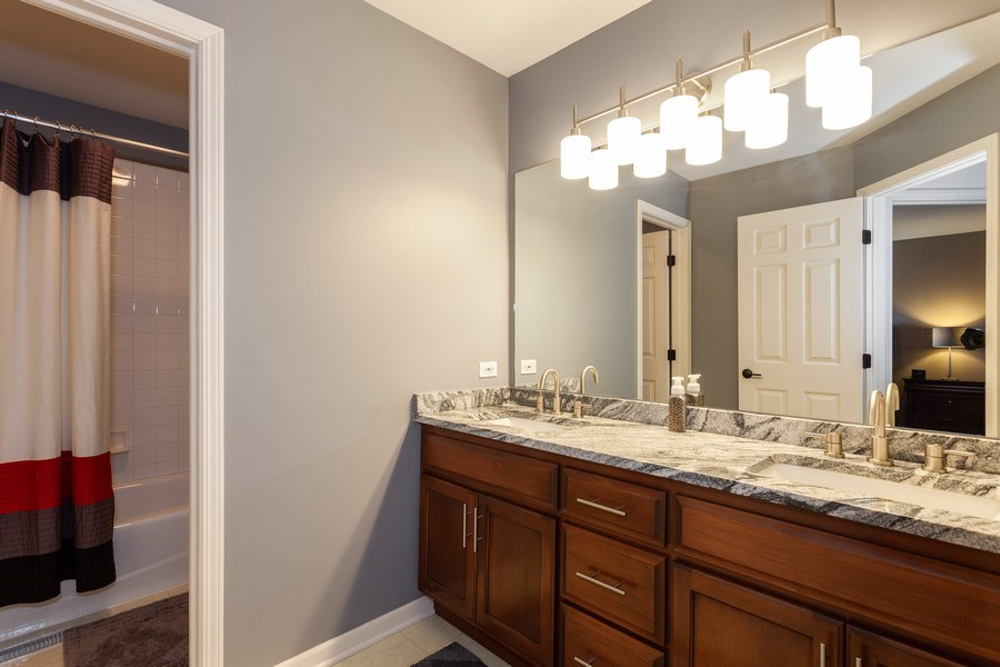 Real Estate Photography - 7 Fenview Ct, Bolingbrook, IL, 60440 - Guest bathroom