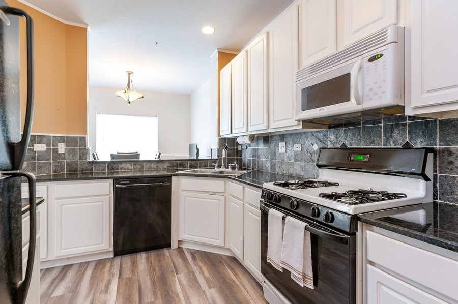 Real Estate Photography - 40030 North Hidden Bunker Ct, Antioch, IL, 60002 - Kitchen