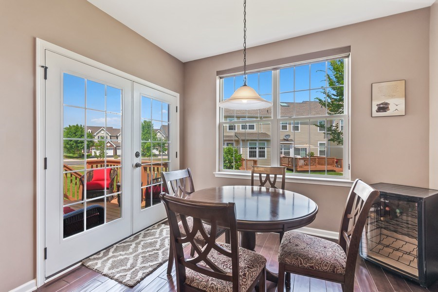 Real Estate Photography - 1212 Falcon Ridge Dr, Elgin, IL, 60124 - Eat-In Kitchen Area W/French Doors Lead to Deck