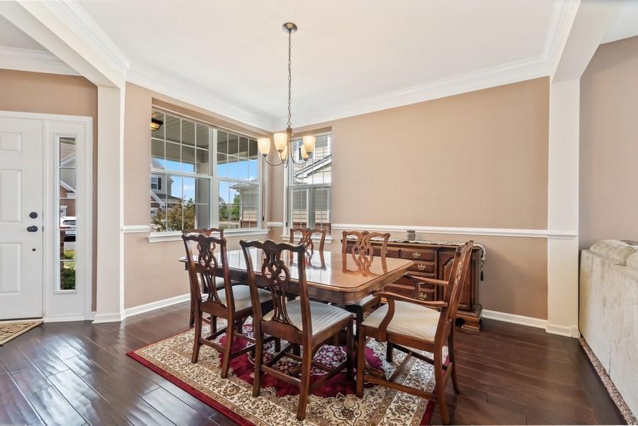 Real Estate Photography - 1212 Falcon Ridge Dr, Elgin, IL, 60124 - Open Dining Room w/Hardwood Floors