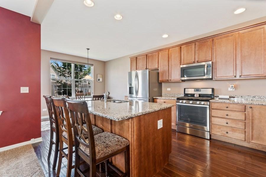 Real Estate Photography - 1212 Falcon Ridge Dr, Elgin, IL, 60124 - Granite Counters & Buffet Style Island