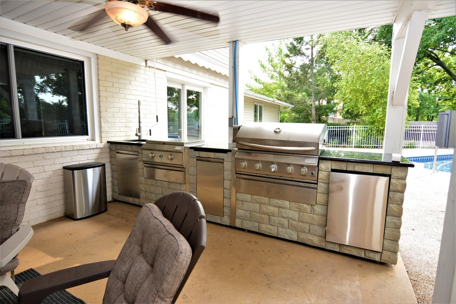 Real Estate Photography - 28812 W. Park Drive, Barrington, IL, 60010 - Walkout Lower level to covered patio. New outdoor